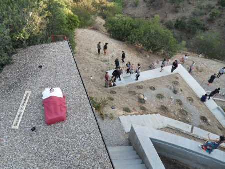 Rikki Rothenberg's Success is Possible: Authentic Movement as Performance on the roof of GuestHaus Residency, on the left