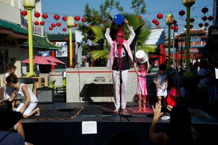 Jamie McMurry and kids at Perform Chinatown. Photo: Christy Roberts.